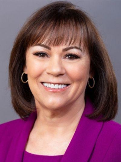 Vicki Puliz with a magenta blazer smiling