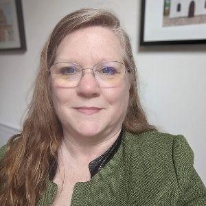 Renée Fontenot smiling with a green blazer on